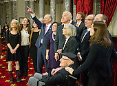 United States Senator Chuck Schumer (Democrat of New York) points to the camera in the gallery as his family prepares to pose for a group photo with US Vice President Joe Biden following his taking the oath of office during a mock swearing-in ceremony in the Old US Senate Chamber in the US Capitol in Washington, DC on Tuesday, January 3, 2017.  Schumer's wife, Iris Weinshall stands between Schumer and Biden.<br /> Credit: Ron Sachs / CNP<br /> (RESTRICTION: NO New York or New Jersey Newspapers or newspapers within a 75 mile radius of New York City)