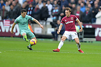 Ainsley Maitland-Niles of Arsenal and Mark Noble of West Ham United during West Ham United vs Arsenal, Premier League Football at The London Stadium on 12th January 2019
