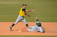 Wayne State Warriors second baseman Jeremy Carrell #5 attempts to turn a double play as Graeme Frye #17 slides in during a game against Slippery Rock at Chain of Lakes Stadium on March 15, 2013 in Winter Haven, Florida.  Illinois State defeated Long Island 6-4.  (Mike Janes/Four Seam Images)