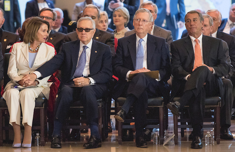 UNITED STATES - JUNE 8 - Senate Democratic Leader Harry Reid holds hands with House Minority Leader Nancy Pelosi as they sit beside Senate Majority Leader Mitch McConnell, second from right, and House Speaker John Boehner, right, during the Congressional Commemoration Ceremony in honor of the 50th anniversary of the Vietnam War, on Capitol Hill in Washington, D.C. on July 8, 2015. (Photo By Al Drago/CQ Roll Call)