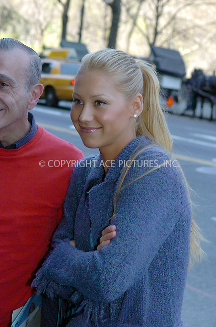 WWW.ACEPIXS.COM ** ** **EXCLUSIVE!!! FEE MUST BE NEGOTIATED BEFORE USE!!!....NEW YORK, APRIL 14, 2005....Anna Kournikova is seen entering her midtown hotel in what appears to be a periwinkle bathrobe, sneakers, a teal tank top and the must have Balenciaga bag. She takes a moment to pose for pictures with autograph hounds. She then enters the hotel and adds a pair of jeans, a hat and sunglasses to the outfit but still retains what looks to be a fuzzy bathrobe with fringe. She then heads to Park Avenue for a walk where she digs around in her Balenciaga bag for  her cell phone.....Please byline: Philip Vaughan -- ACE PICTURES... *** ***  ..Ace Pictures, Inc:  ..Craig Ashby (212) 243-8787..e-mail: picturedesk@acepixs.com..web: http://www.acepixs.com