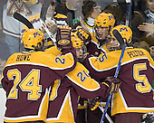 Celebrating Bostrom's goal - Mike Howe, Evan Kaufman, Justin Bostrom, PJ Atherton, Derek Peltier - The University of Minnesota Golden Gophers defeated the University of North Dakota Fighting Sioux 4-3 on Saturday, December 10, 2005 completing a weekend sweep of the Fighting Sioux at the Ralph Engelstad Arena in Grand Forks, North Dakota.