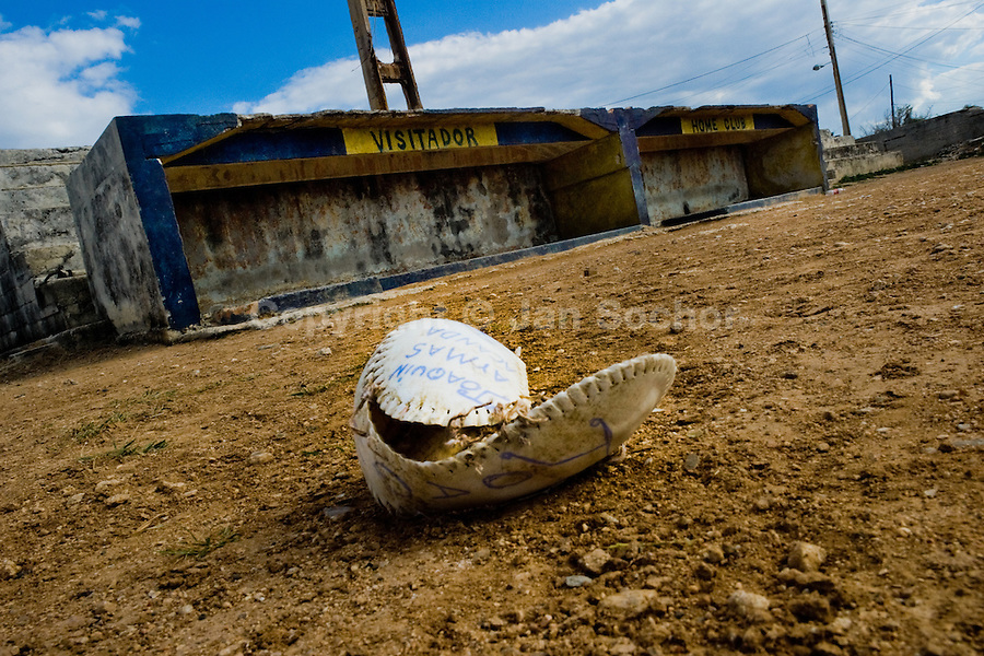 A broken baseball ball lies on the gravel sand field in a small village close to the Eastern Havana, Cuba, 14 February 2009. About 50 years after the national rebellion, led by Fidel Castro, and adopting the communist ideology shortly after the victory, the Caribbean island of Cuba is the only country in Americas having the communist political system. Although the Cuban state-controlled economy has never been developed enough to allow Cubans living in social conditions similar to the US or to Europe, mostly middle-age and older Cubans still support the Castro Brothers' regime and the idea of the Cuban Revolution. Since the 1990s Cuba struggles with chronic economic crisis and mainly young Cubans call for the economic changes.