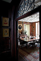 The entrance to the dining room is hung with portraits