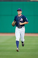 Northwest Arkansas Naturals center fielder Donald Dewees Jr. (16) jogs back to the dugout during a game against the Midland RockHounds on May 27, 2017 at Arvest Ballpark in Springdale, Arkansas.  NW Arkansas defeated Midland 3-2.  (Mike Janes/Four Seam Images)
