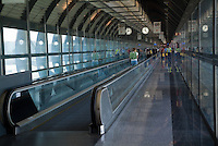 Passengers moving through the departures lounge at Madrid-Barajas Airport, Madrid, Spain.