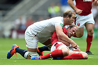 Alun Wyn Jones of Wales is tackled by Joe Launchbury of England. Quilter International match between England and Wales on August 11, 2019 at Twickenham Stadium in London, England. Photo by: Patrick Khachfe / Onside Images