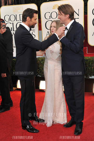 Hugh Jackman & Amanda Seyfried & Tom Hooper at the 70th Golden Globe Awards at the Beverly Hilton Hotel..January 13, 2013  Beverly Hills, CA.Picture: Paul Smith / Featureflash