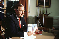 Washington DC., USA, September 5, 1989<br /> President George H.W. Bush holds up a bag of crack cocaine during his first address to the nation from the Oval Office. &quot;This is crack cocaine, it was seized a few days ago in a park across the street from the White House&quot; he said showing how the drug trade had spread to even the president's own neighborhood. The three ounces of crack were purchased for $2,400 by  DEA agents from a drug dealer that they lured to Lafayette Park across the street from the White House. Credit: Mark Reinstein/MediaPunch