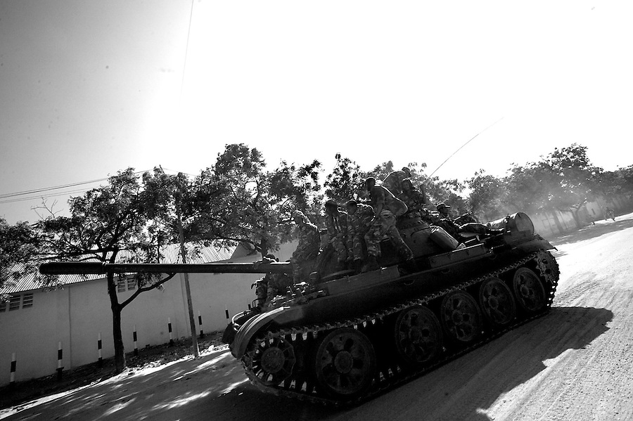 An Ethiopian T55 Tank rolls on the KM 4 road in Southern Mogadishu, Somalia on tuesday Jan 02 2007..Only a few days after the fall of the United Islamic Courts in Mogadishu, Ethiopian and Transitional Federal Government troops are patrolling the city and securing strategic locations..The people in Mogadishu appear confused and doubtful on t