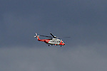 The Coast Guard Rescue Helicopter heading to the Lourdes Hospital in Drogheda during the rescue of two Razor Fishermen by the Coast Guard on Saturday 23rd August 2014.<br /> Picture:  Thos Caffrey / www.newsfile.ie