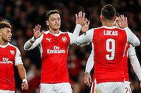 Mesut Ozil of Arsenal (2nd left) celebrates scoring his 2nd goal of the game to make it 5-0 during the UEFA Champions League match between Arsenal and PFC Ludogorets Razgrad at the Emirates Stadium, London, England on 19 October 2016. Photo by David Horn / PRiME Media Images.