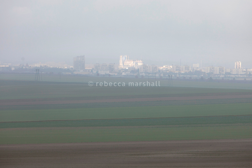 The cathedral of Notre-Dame de Reims seen from the hills east of Reims early on a foggy morning, Reims, France, 11 November 2015. During World War I when German shells destroyed much of the cathedral, the German troops were situated on these hills.