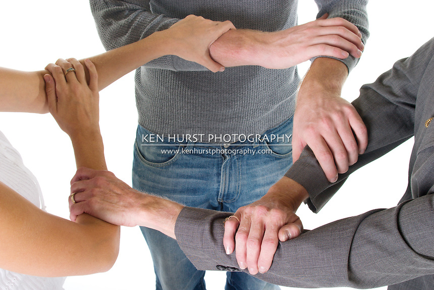Three person business team with hands and arms linked in unity and support...If at all possible, please let me know how my images are used.  Thank you.