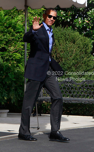 United States President Barack Obama waves to the assembled press as he departs the White House in Washington, DC for the opening of the UN General Assembly in New York , New York on September 18, 2016.<br /> Credit: Dennis Brack / Pool via CNP