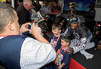 Jul. 27, 2013; Sonoma, CA, USA: NHRA top fuel dragster driver Antron Brown (right) poses for a photo with young fans during qualifying for the Sonoma Nationals at Sonoma Raceway. Mandatory Credit: Mark J. Rebilas-