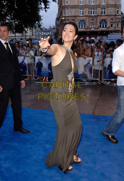 "GONG LI.European film premiere""Miami Vice"".Odeon cinema Leicester Square.27th July 2006 in London, England.Ref: FIN.full length waving brown green dress hand waving.www.capitalpictures.com.sales@capitalpictures.com.©Steve Finn/Capital Pictures."