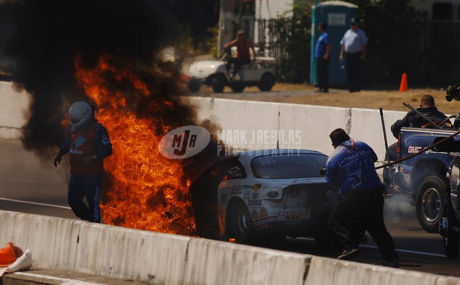 NHRA Pro Stock racer Ron Krisher crashes and catches fire Pacific Raceways Seattle Washington Mandatory credit: Mark J. Rebilas