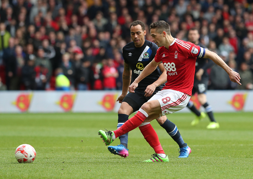 Nottingham Forest's Chris Cohen and Blackburn Rovers' Elliott Bennett<br /> <br /> Photographer Rachel Holborn/CameraSport<br /> <br /> The EFL Sky Bet Championship - Nottingham Forest v Blackburn Rovers - Friday 14th April 2016 - The City Ground - Nottingham<br /> <br /> World Copyright &copy; 2017 CameraSport. All rights reserved. 43 Linden Ave. Countesthorpe. Leicester. England. LE8 5PG - Tel: +44 (0) 116 277 4147 - admin@camerasport.com - www.camerasport.com