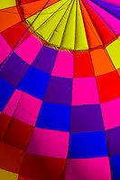 Interior of acolorful hot air balloon envelope (balloon is named Sunglow) as it was being inflated, Albuquerque International Balloon Fiesta, Albuquerque, New Mexico USA.