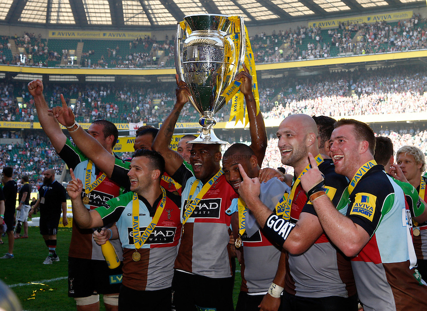 Photo: Richard Lane/Richard Lane Photography. Harlequins v Leicester Tigers. Aviva Premiership Final. 26/05/2012. Quins' Ugo Monye holds aloft the trophy as the team celebrate.