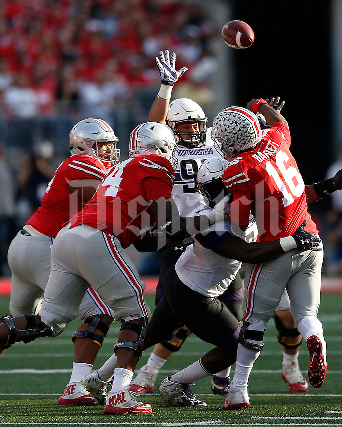 Ohio State Buckeyes quarterback J.T. Barrett (16) throws during the second quarter of the NCAA football game between the Ohio State Buckeyes and the Northwestern Wildcats at Ohio Stadium on Saturday, October 29, 2016. (Columbus Dispatch photo by Jonathan Quilter)