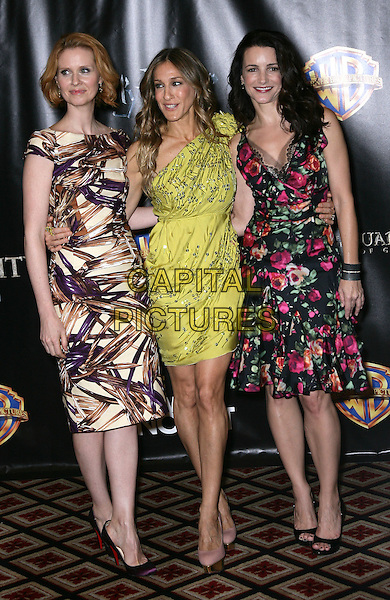 CYNTHIA NIXON, SARAH JESSICA PARKER & KRISTIN DAVIS.Warner Brothers ShoWest Presentation at the Paris Resort Hotel and Casino, Las Vegas, Nevada, USA..March 18th, 2010.full length purple cream brown pattern print green one shoulder pink black floral print dress  SATC Sex and the city  sjp  silver beads beaded .CAP/ADM/MJT.© MJT/AdMedia/Capital Pictures.