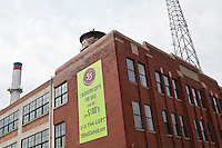 A sign showing 1 bedroom lofts for sale is seen in Detroit (Mi) Midtown Saturday June 8, 2013.