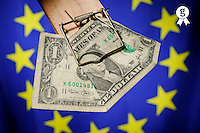 One dollar bill in mousetrap on European Union Flag (Licence this image exclusively with Getty: http://www.gettyimages.com/detail/sb10068346ap-001 )