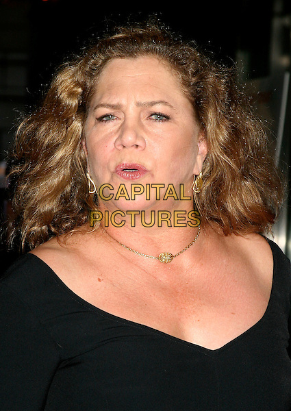 "KATHLEEN TURNER.""The Constant Gardener"" New York Premiere,.Loews Lincoln Square, .New York City, 8th August 2005.portrait headshot v-neck black dress gold chain necklace earrings mouth pucker pout eye contact.www.capitalpictures.com.sales@capitalpictures.com.©Capital Pictures"