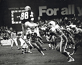 Washington Redskin wide receiver Danny Buggs (88) leaps to pull in a Joe Theismann pass in the waning seconds of the first half of the game against the St. Louis Cardinals at RFK Stadium in Washington, DC on November 11, 1979.  The Skins ultimately scored on the drive.  Defensing on the play are Cardinals' right cornerback Roger Wehrli (22) and right inside linebacker Kurt Allerman (50).  The Redskins won the game 30 -28.<br /> Credit: Arnie Sachs / CNP
