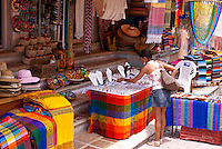 Young woman in a Mexican handicrafts store, in Playa del Carmen, Riviera Maya, Quintana Roo, Mexico.