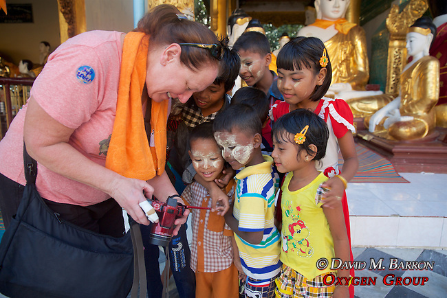 Kristina Timmerman Showing Burmese Children Their Photo<br /> At Shwedagon Pagoda
