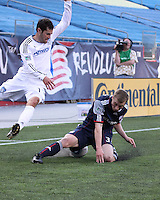 New England Revolution forward Zak Boggs (33) slide tackles San Jose Earthquakes midfielder Joey Gjertsen (17) near the Revolution corner.  The New England Revolution and San Jose Earthquakes play to a scoreless draw at Gillette Stadium on May 15, 2010