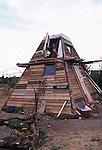 A Wooden PYRAMID  house built from skip  material on the site of the Wandsworth Eco village. London