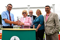 Connections of Field of Vision receive their  trophy from sponsors after winning the Peter Symonds Catering Handicap (Class 5),   during Afternoon Racing at Salisbury Racecourse on 7th August 2017