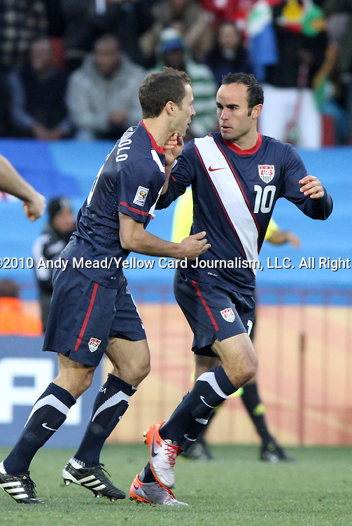 18 JUN 2010: Landon Donovan (USA) (10) celebrates his goal with Steve Cherundolo (USA) (left). The Slovenia National Team played the United States National Team to a 2-2 at Ellis Park Stadium in Johannesburg, South Africa in a 2010 FIFA World Cup Group C match.