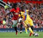 Axel Tuanzebe of Manchester United in action with Wilfried Zaha of Crystal Palace during the English Premier League match at the Old Trafford Stadium, Manchester. Picture date: May 21st 2017. Pic credit should read: Simon Bellis/Sportimage