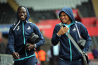 L-R Modou Barrow and Jefferson Montero of Swansea City arrive prior to the Premier League match between Swansea City and Hull City at the Liberty Stadium, Swansea on Saturday August 20th 2016