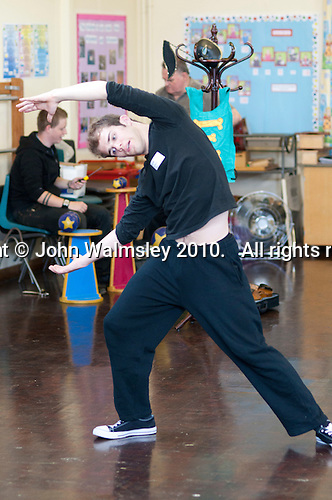 Students from Rose Bruford College exercise and warm up before performing at a state Infant School.