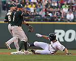 Oakland Athletics second baseman Eric Sogard (28) turns a double play against the Seattle Mariners in the fourth inning September 13, 2014 at Safeco Field in Seattle.  Being forced out at second is Kendrys Morales.  UPI/Jim Bryant