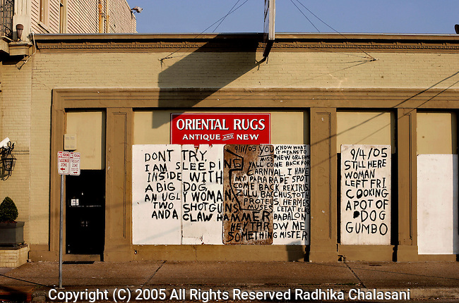 New Orleans-September 15: A shopfront carries messages to looters and to a family member September 15, 2005 in New Orleans. (Photo By Radhika Chalasani/Getty Images)