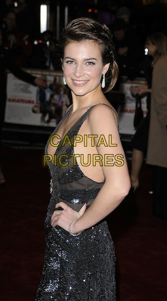 "CAMILLA ARFWEDSON.World Premiere of ""Bunch of Amateurs"" at the Odeon, Leicester Square London, England..November 17th 2008.half length hands on hips black halterneck low cut plunging neckline cleavage beaded sequined sheer earrings dress silver .CAP/CAN.©Can Nguyen/Capital Pictures."