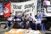 Roma 30 Marzo 2012..Vai Asmara, Ambasciata Tunisia..Una delegazione di famiglie tunisine arrivate in Italia per cercare i propri figli, che, partiti a Marzo dello scorso anno su diverse imbarcazioni alla volta dell'Italia, sono spariti.I genitori mostrano le foto dei figli scomparsi.