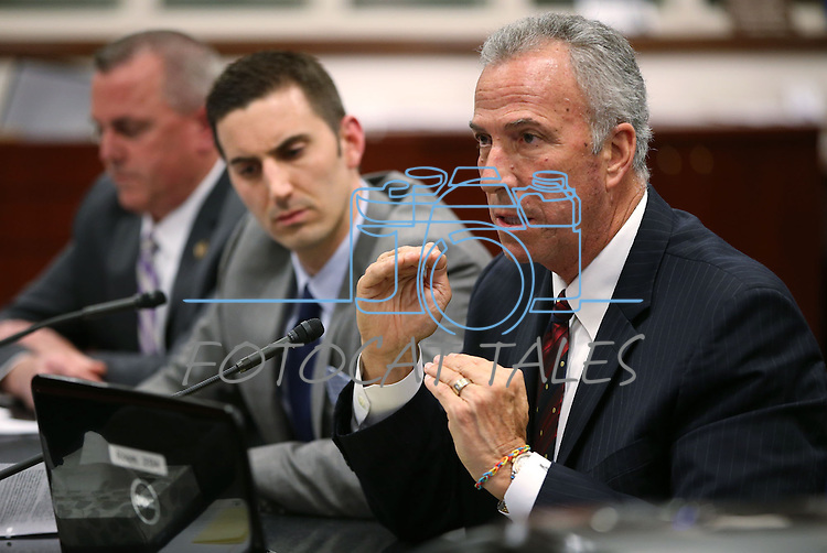 From left, Douglas County District Attorney Mark Jackson, Assistant Attorney General Wes Duncan and Clark County District Attorney Steve Wolfson testify in a hearing at the Legislative Building in Carson City, Nev., on Wednesday, May 6, 2015. <br /> Photo by Cathleen Allison