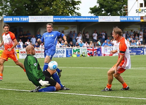 June 17th 2017, Gander Green Lane, Sutton, England; Football Charity Match; Chelsea Legends versus Rangers Legends; Chelsea Keeper Tony Warner saves a shot from Rangers Paul Walsh