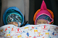 Brooks Whitney, left, and Ruby Joy Whitney, right, snooze while their mom, former Olympic skier Holly Brooks, helps out during the 2018 U.S. National Cross Country Ski Championships at Kincaid Park in Anchorage.