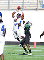 Armwood Hawks wide receiver Alvin Bailey #3 attempts to catch a pass before it is broken up by defensive back Jonathan Harris #31 during the second quarter of the Florida High School Athletic Association 6A Championship Game at Florida's Citrus Bowl on December 17, 2011 in Orlando, Florida.  The score at halftime is Armwood 16 - Miami Central 14.  (Mike Janes/Four Seam Images)