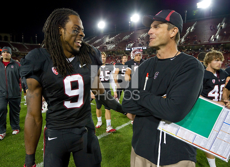 STANFORD, CA - SEPTEMBER 18, 2010: Head coach Jim Harbaugh laughs with Richard Sherman after a football game against Wake Forest at Stanford University. Stanford won 68-24.
