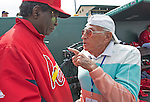 2 March 2013: Baseball America photographer Morris Fostoff gives advice to Hall of Fame Cardinal Lou Brock between innings of a Spring Training game between the Washington Nationals and the St. Louis Cardinals at Roger Dean Stadium in Jupiter, Florida. The Nationals defeated the Cardinals 6-2 in their first meeting since the NLDS series in October of 2012. Mandatory Credit: Ed Wolfstein Photo *** RAW (NEF) Image File Available ***